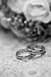 Wedding rings. With bride bouquet inblack and white Stock Images