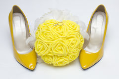 Wedding  rings  with bride bouquet and shoes Stock Photo