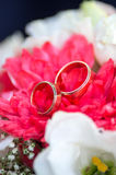 Wedding rings on bride`s bouquet. Golden wedding rings are on the petals of a bridal bouquet of chrysanthemums Stock Photos