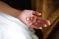 Wedding rings on the bride`s hand. Two rings on the palm stock image