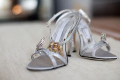 Wedding rings with bride sandals Royalty Free Stock Image