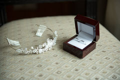Wedding rings in a brown box and a crown stock images