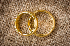 Wedding rings on the burlap Stock Image