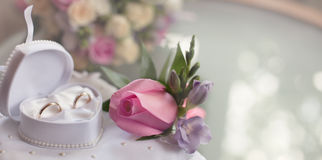 WEdding rings and  buton rozy rosebud Stock Photo