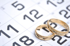 Wedding rings on calendar Royalty Free Stock Photography