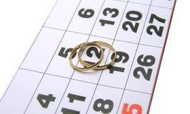 Wedding rings on a calendar. Closeup royalty free stock photos