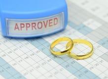 Wedding Rings on Calender. Couple of Wedding Rings on Calender symbolizing wedding date or anniversary Stock Photography