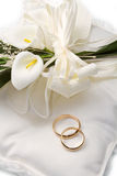 Wedding rings with calla Stock Photos