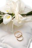 Wedding rings with calla Stock Photos