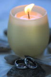 Wedding Rings and Candle stock photo