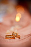 Wedding rings and candles Stock Photo