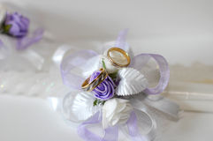 Wedding rings. With wedding candles stock image