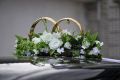 Wedding rings on the car Stock Photo