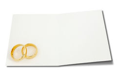 Wedding rings on the card for text Royalty Free Stock Photo