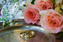Wedding rings before the ceremony, with decorated Champagne glasses and roses. Wedding rings before the ceremony with decorated Champagne glasses and roses Royalty Free Stock Photography