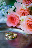 Wedding rings before the ceremony, with decorated Champagne glasses and roses. Wedding rings before the ceremony with decorated Champagne glasses and roses Stock Images