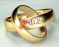 Wedding Rings Ceremony 2020. Two gold marriage rings with a ceremony in 2020. White background Royalty Free Stock Photography