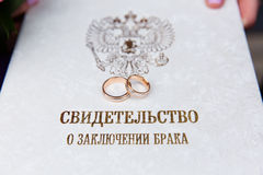 Wedding rings on `certificate of marriage` Stock Images