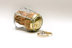 Wedding rings and champagne cork Royalty Free Stock Images