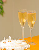 Wedding rings and champagne glasses Stock Photo