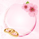 Wedding rings and cherry blossom design Royalty Free Stock Photos