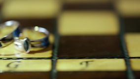 Wedding Rings on the Chess Board Slider stock video footage