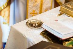 Wedding rings on church Stock Photo