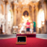 Wedding rings in church Stock Photography