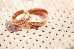 Wedding rings  close-up. Wedding rings  sparkle on a bright surface Royalty Free Stock Image