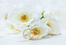 Wedding Rings. Close-up of wedding rings on background of roses Royalty Free Stock Photo