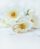 Wedding Rings. Close-up of wedding rings on background of roses Royalty Free Stock Images