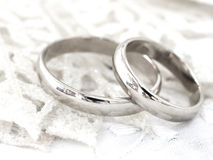 Wedding rings. Close up of the wedding rings on bright silver background Royalty Free Stock Photos