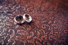 Wedding rings close-up on a brown background Royalty Free Stock Photo