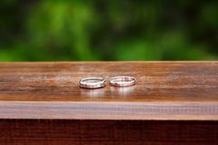 Wedding rings close up in rustic style Stock Photos