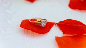 Wedding rings closeup on a pattern background. Royalty Free Stock Photography
