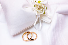 Wedding rings in a cloth bag. Wedding rings in a white cloth bag with flower Stock Photography