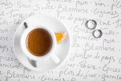 Wedding rings and coffee cup. A cup of coffee on a table with the wedding rings Stock Photos