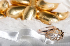 Wedding rings on colorful fabric Stock Images