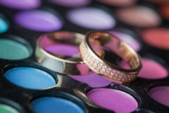 Wedding rings on the cosmetic mascara.  Royalty Free Stock Images