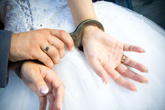 Wedding rings with the couple Stock Images