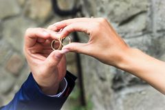 Wedding rings. Wedding couple holding their rings together Royalty Free Stock Photography