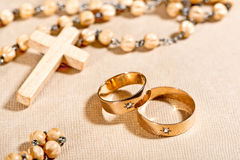 Wedding Rings and Cross Stock Photo
