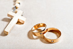 Wedding Rings and Cross Stock Photos