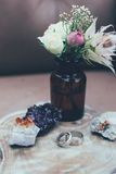 Wedding rings, crystals and roses Stock Photos