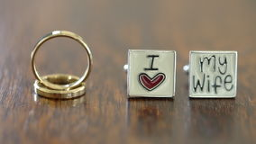 Wedding Rings and Cufflinks on the Wooden Table stock video footage