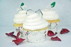 Wedding rings on cupcakes Stock Image