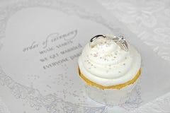 Wedding rings on cupckcake Stock Photo