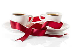 Wedding rings cups of coffee Royalty Free Stock Image