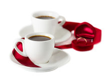 Wedding rings cups of coffee Stock Photos