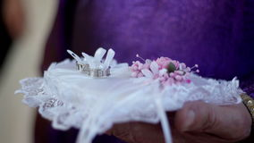 Wedding rings on cushion. Wedding rings on a white cushion stock video footage